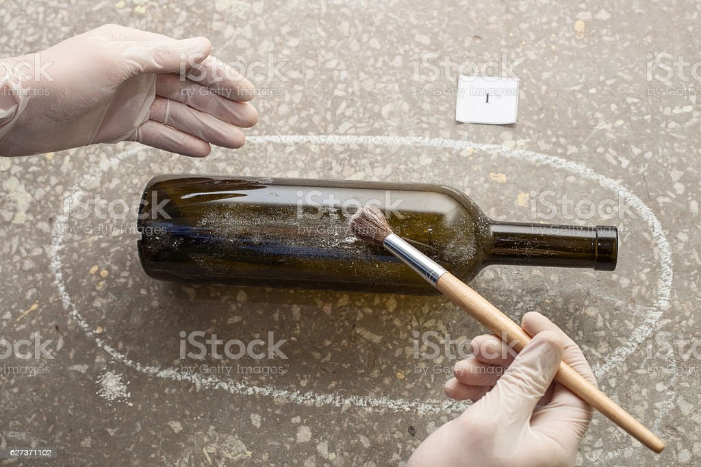 discovery of evidence. prints on the bottle. stock photo