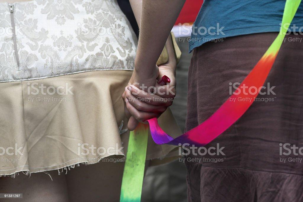 Discrete : Girls Holding Hands #1 royalty-free stock photo