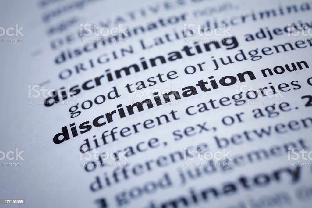 Discrimination: Dictionary Close-up stock photo