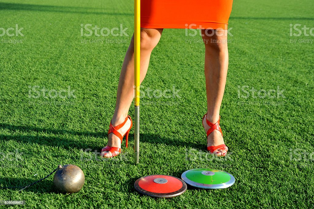 discus, javelin and hammer girl with stilettos stock photo