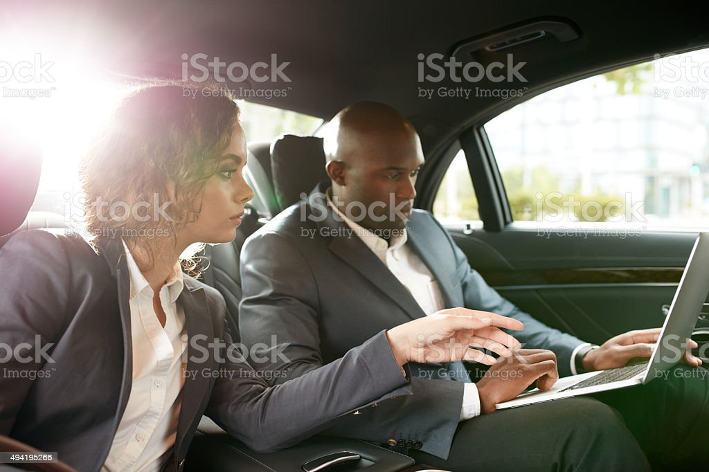 Discuss business strategy while driving to a meeting stock photo