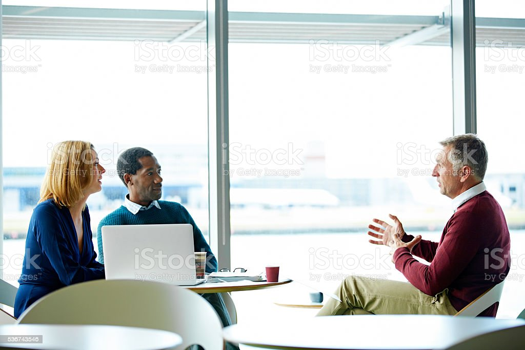 Discussing airport business stock photo