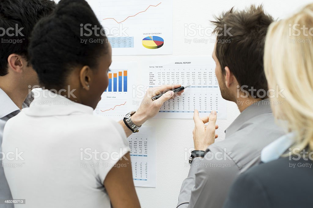 Discussing annual report stock photo