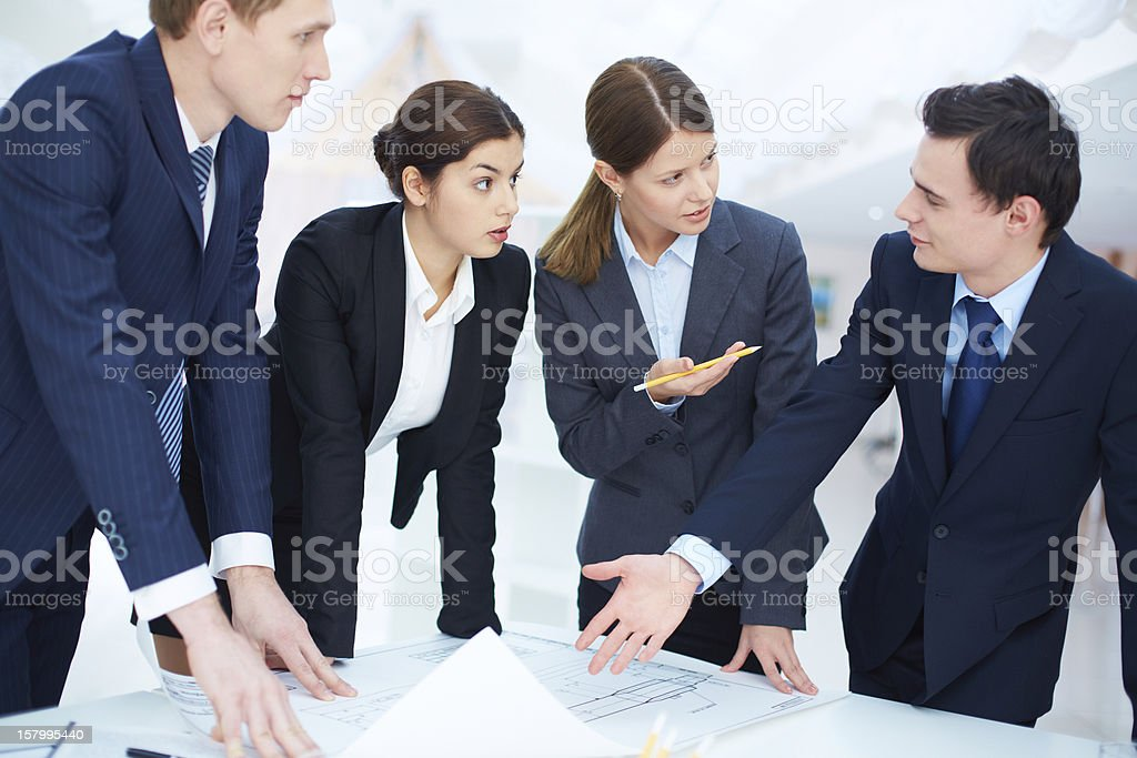 Discussing blueprint royalty-free stock photo