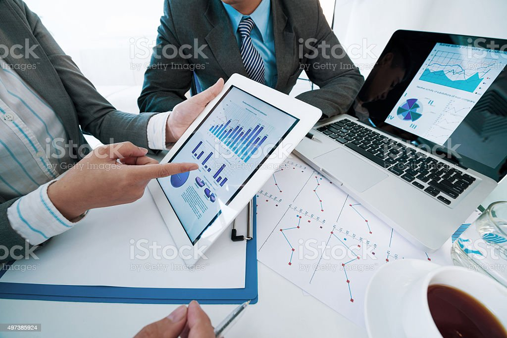 Discussing business graphs stock photo
