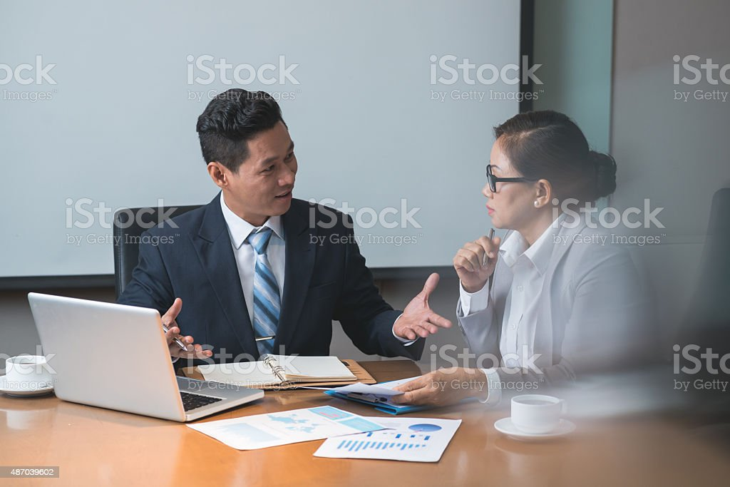 Discussing business ideas stock photo