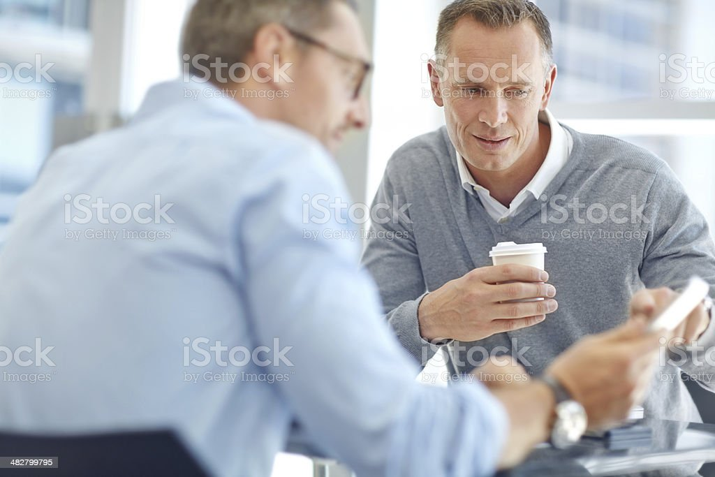Discussing business policies together royalty-free stock photo