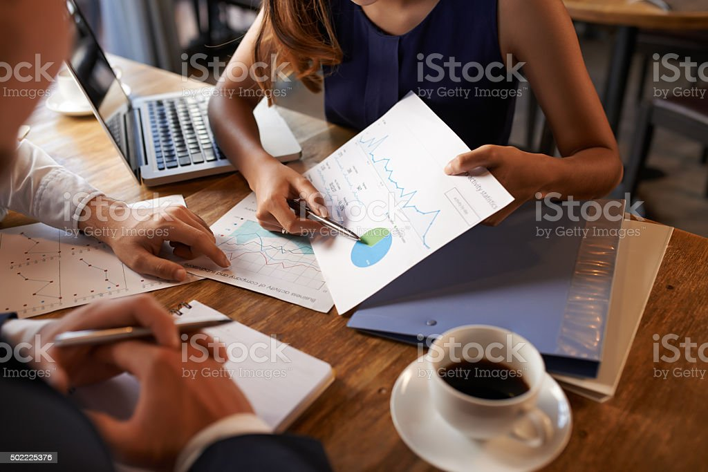 Discussing business statistics stock photo