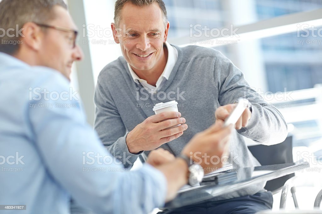 Discussing corporate ideas and proposals together royalty-free stock photo