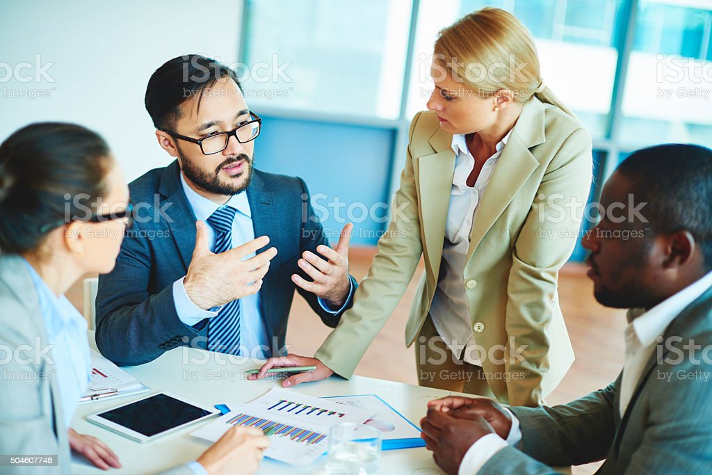 Discussing documents stock photo