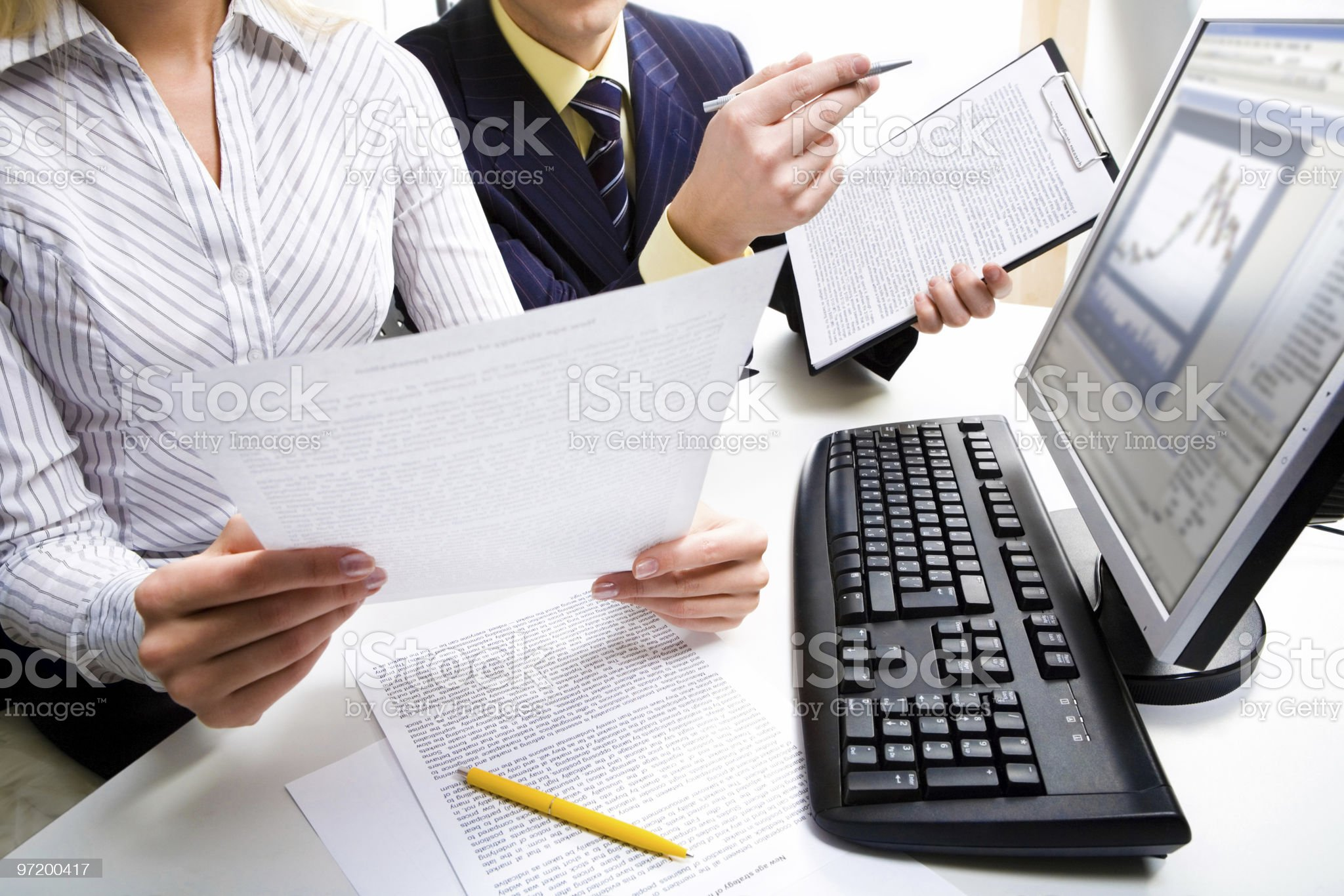 Discussing documents royalty-free stock photo