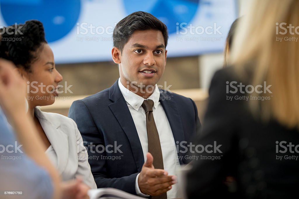 Discussing New Ideas in a Business Meeting stock photo