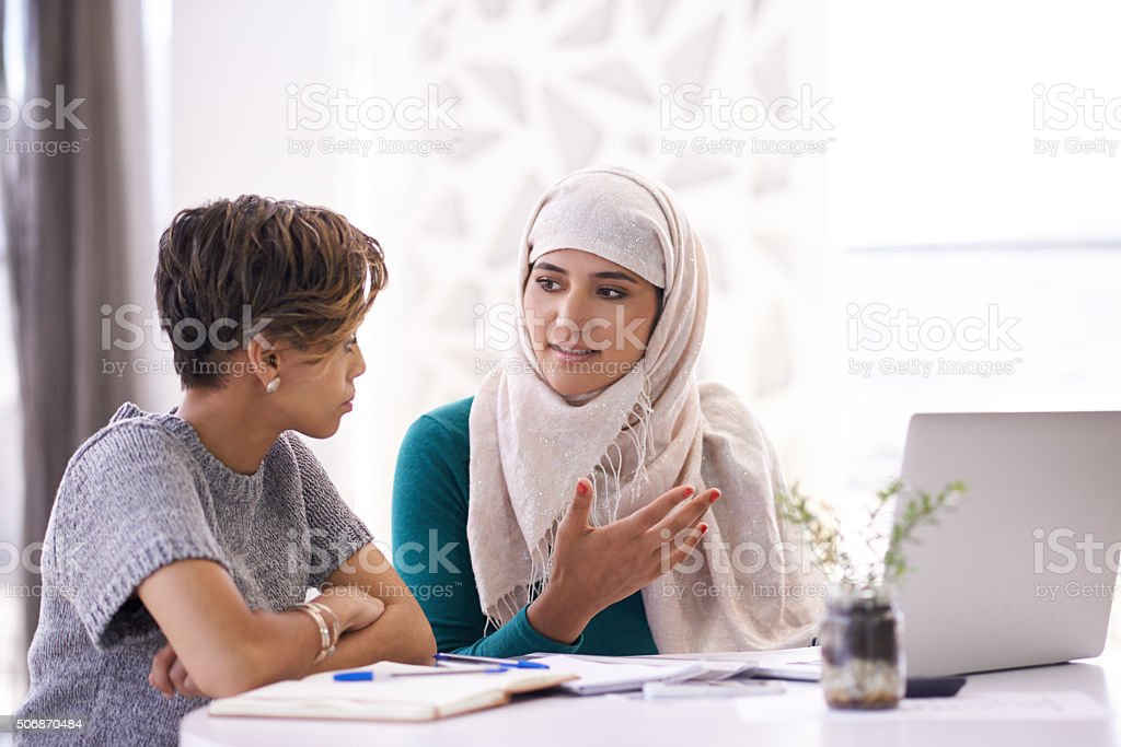 Discussing new ways to up their clientele stock photo