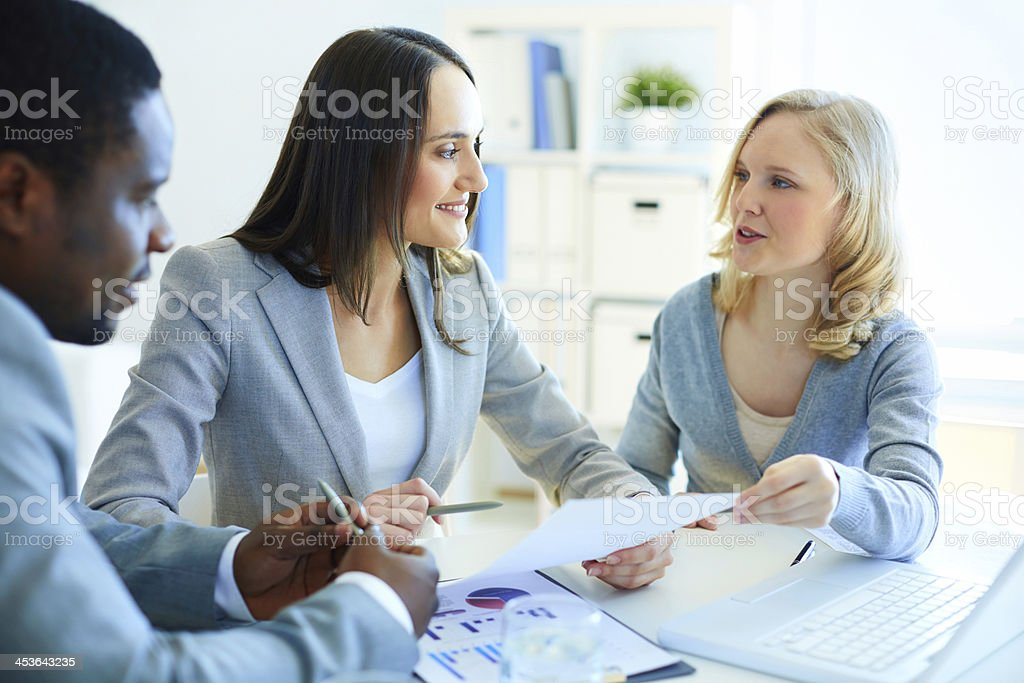 Discussing papers stock photo