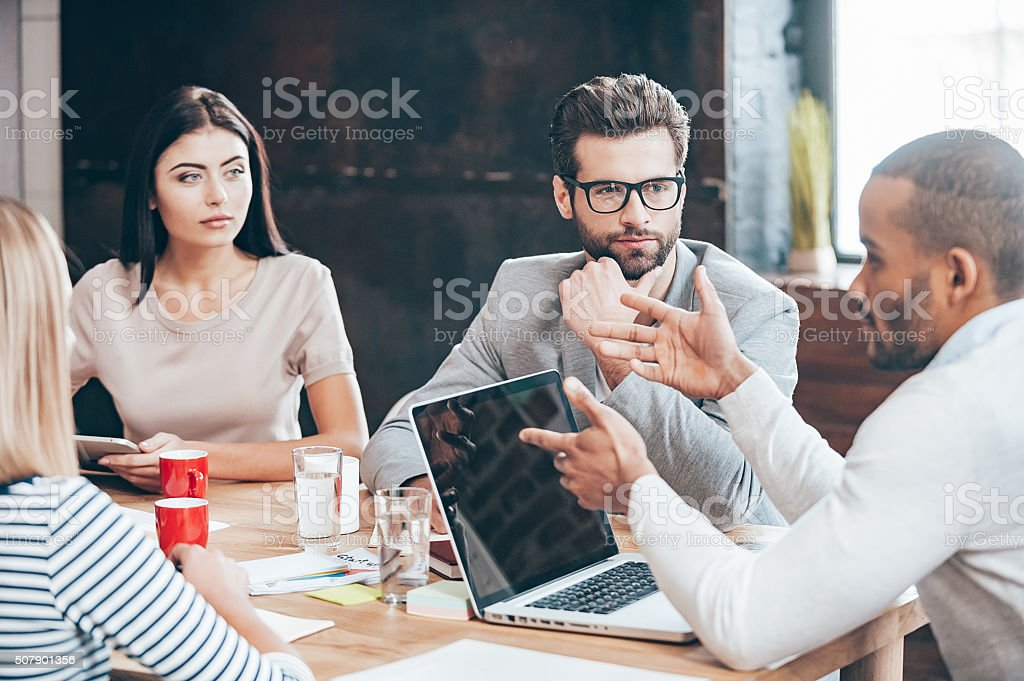 Discussing some business issues. stock photo