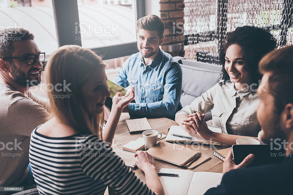 Discussing the latest news. stock photo