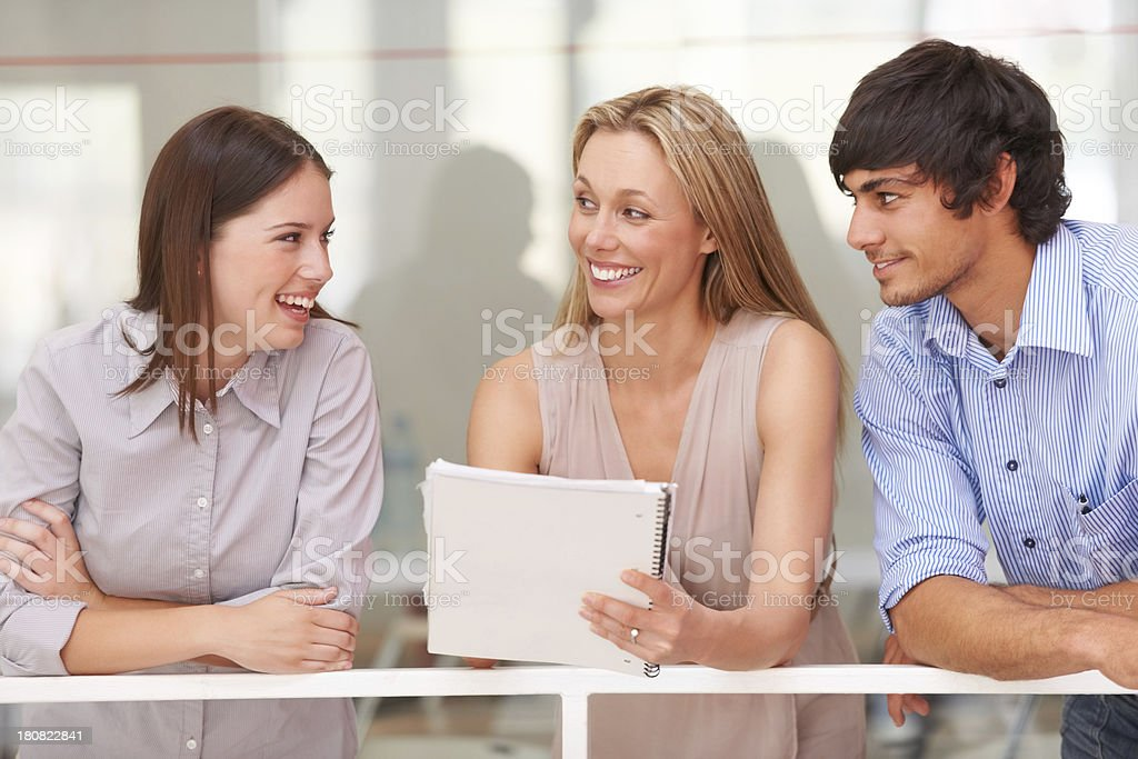 Discussing their work proposal together stock photo