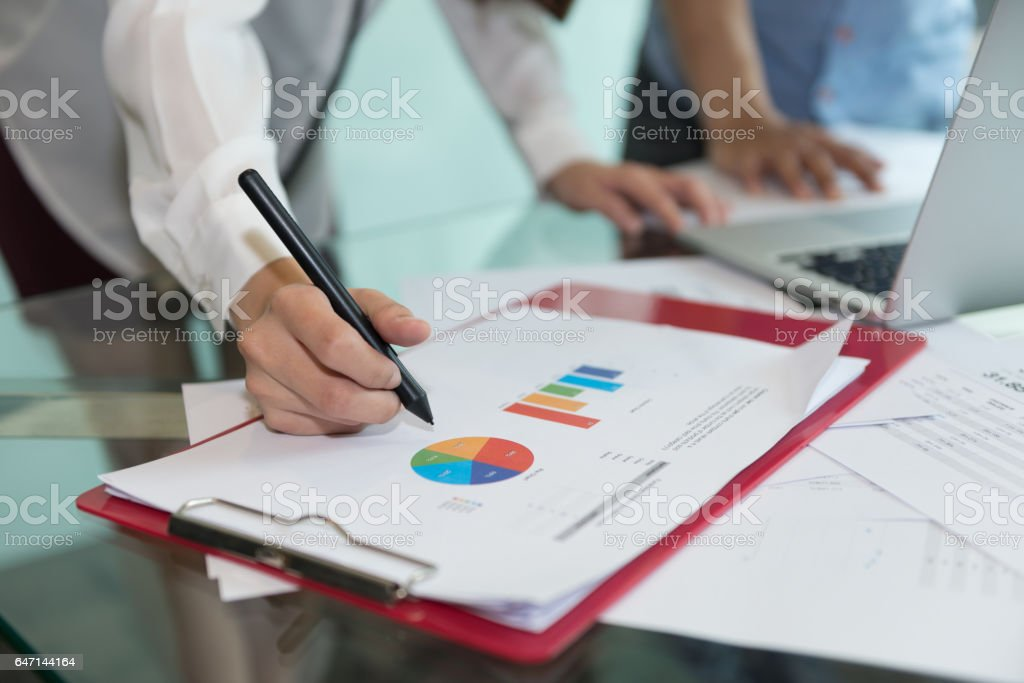Discussing, writing, estimating business profit plan of company stock photo