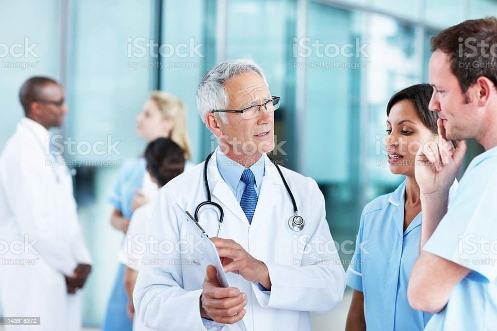 Discussion about patient's report royalty-free stock photo