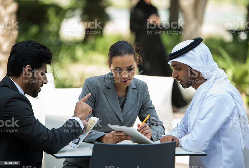Discussion among Arabic business men and woman. stock photo