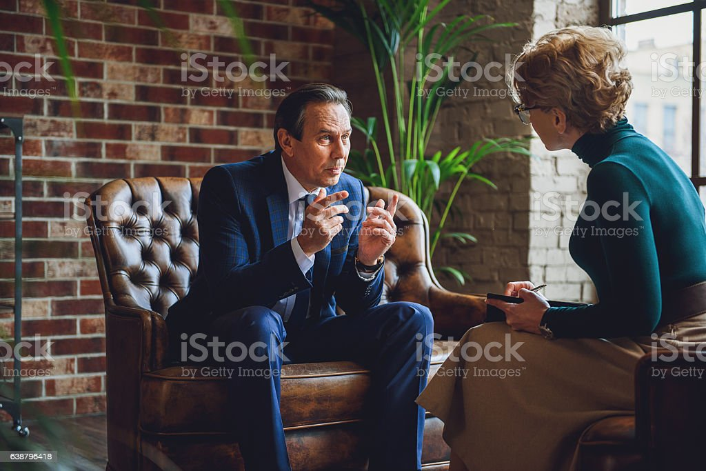 Discussion between advisor and patient stock photo