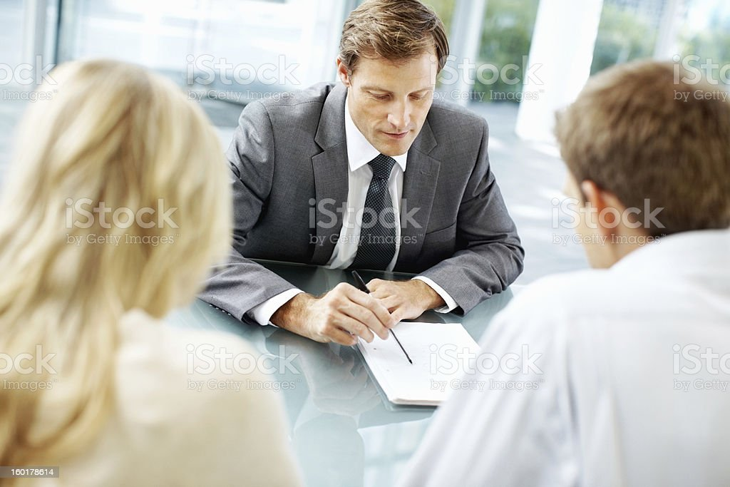 Discussion between the leader and his associates stock photo