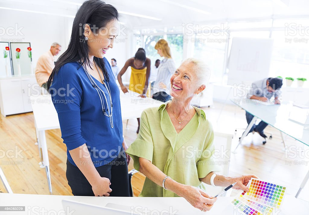 Discussion of Two Designers inside a Design Studio stock photo