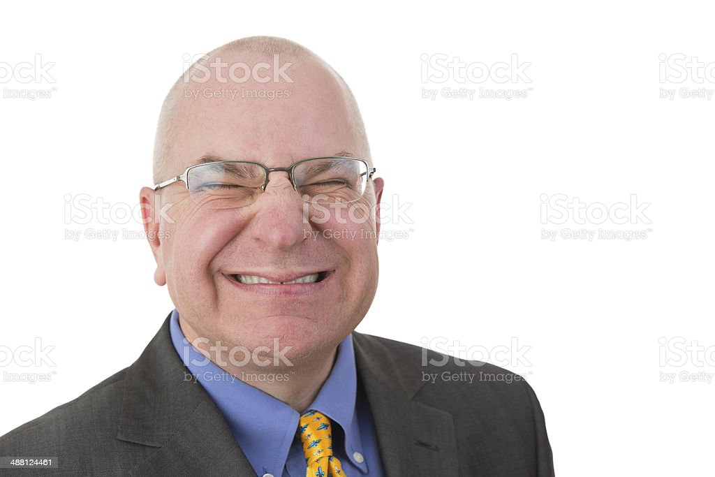 Disdainful businessman grimacing in disgust stock photo