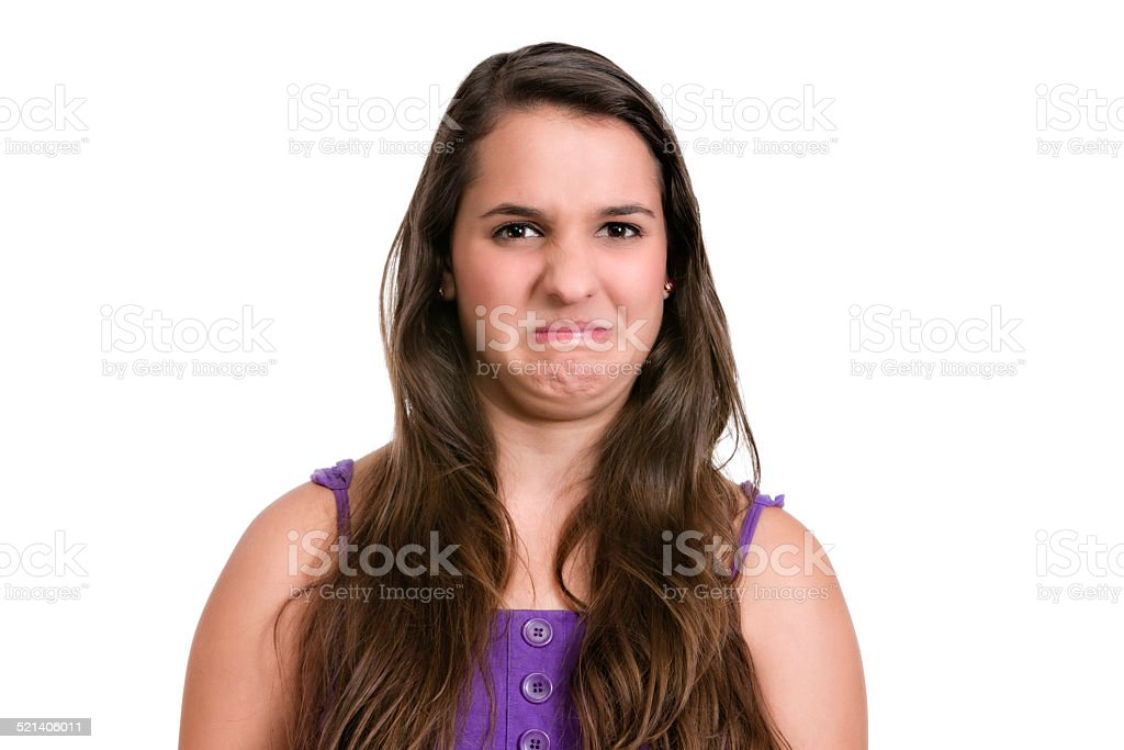 Disgunting and unpleasant smell. Hispanic  young woman. Expression series. stock photo