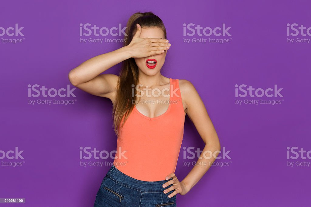Disgusted Woman Cover Her Eyes With Hand stock photo