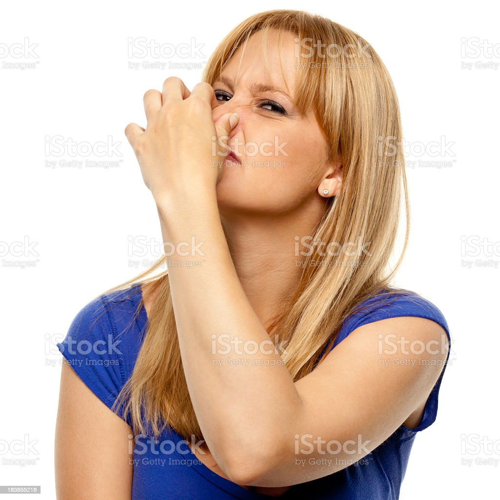 Disgusted Woman Pinches Nose stock photo