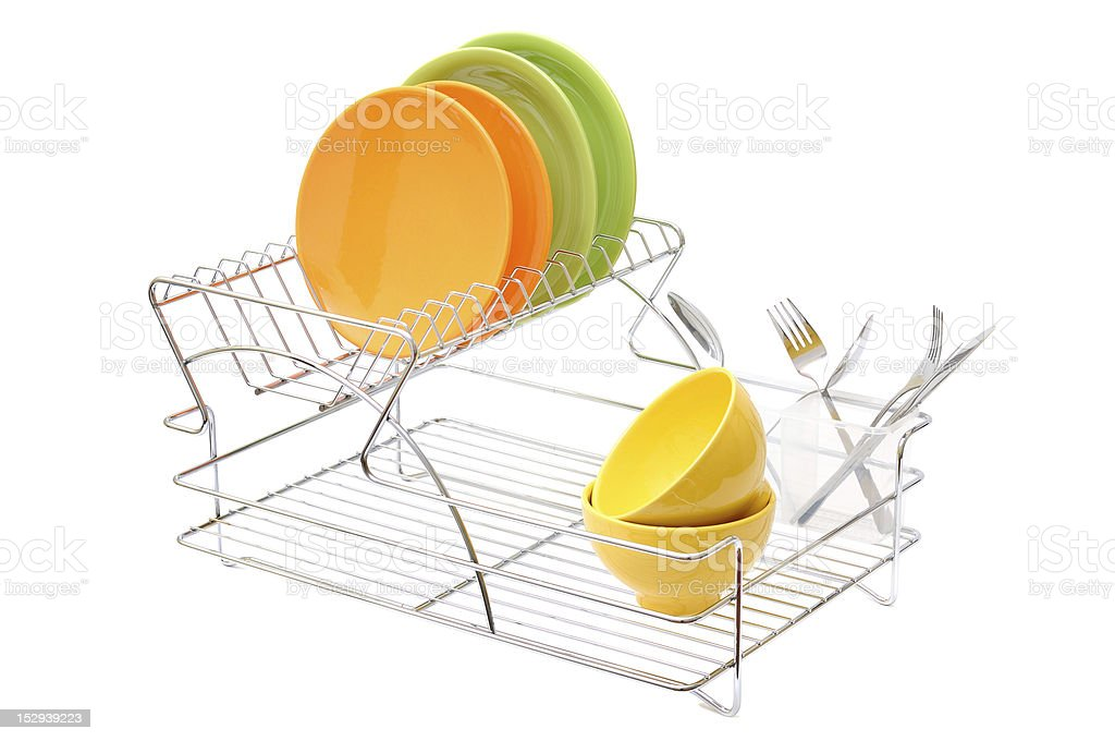 Dish drainer with cleaned dishes stock photo