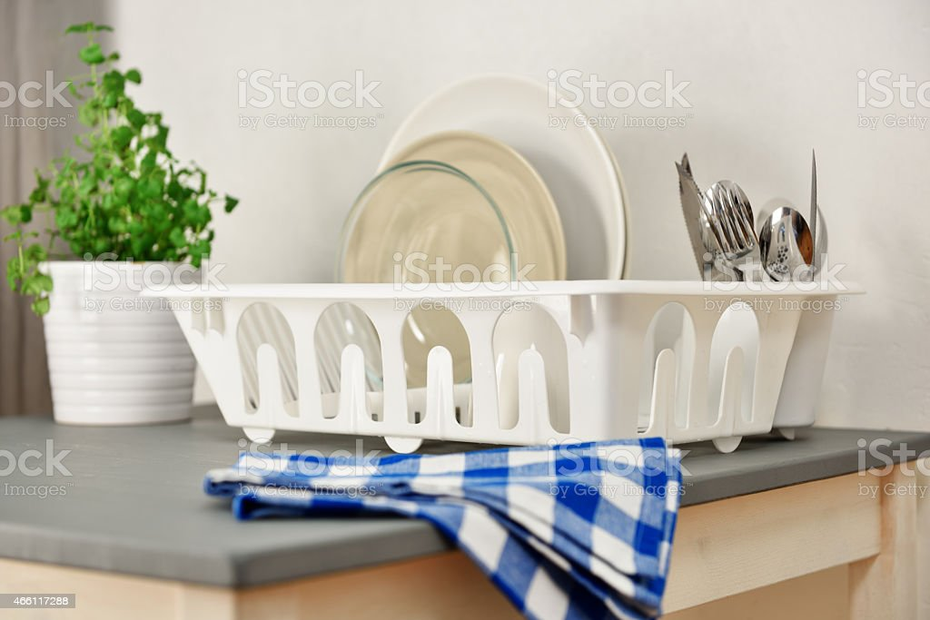 Dish drainer with plates and silverware stock photo