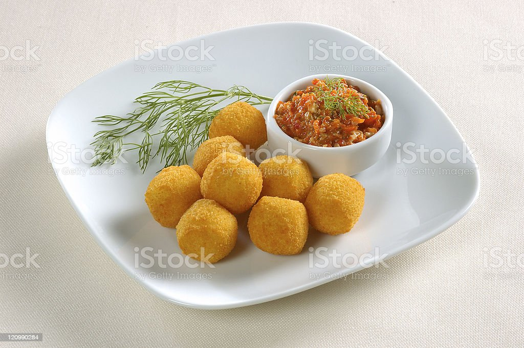 Dish of croquettes with sauce bowl stock photo