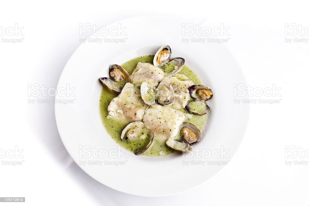Dish of hake with clams in green sauce stock photo