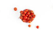 Dish of Italian raw red tomatoes cherry closeup