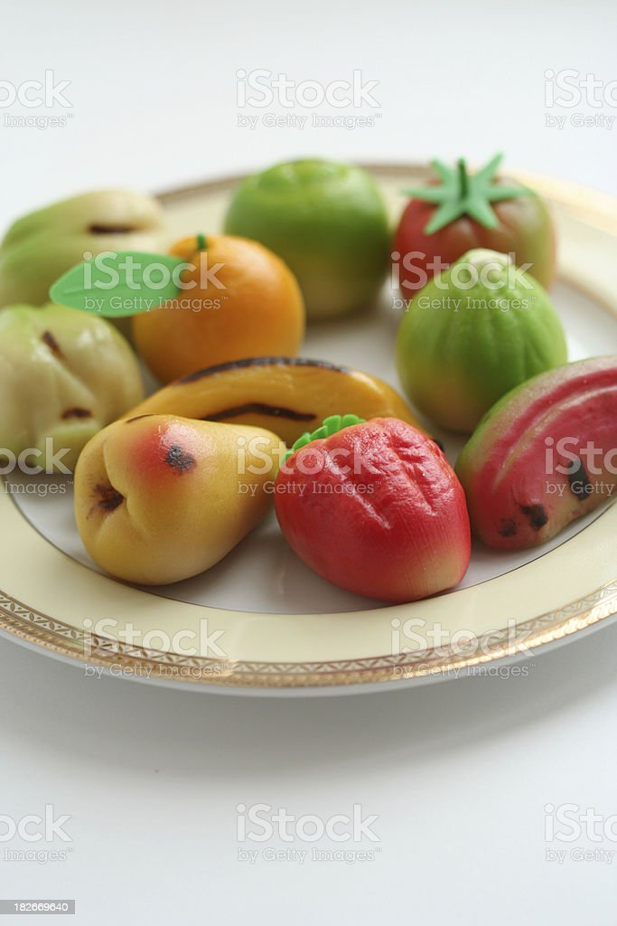 Dish of marzipan fruit pastries royalty-free stock photo