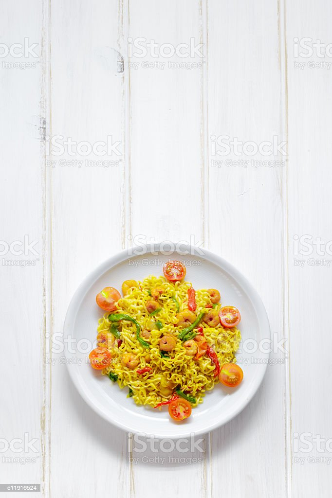 Dish of noodles with prawns and vegetables stock photo