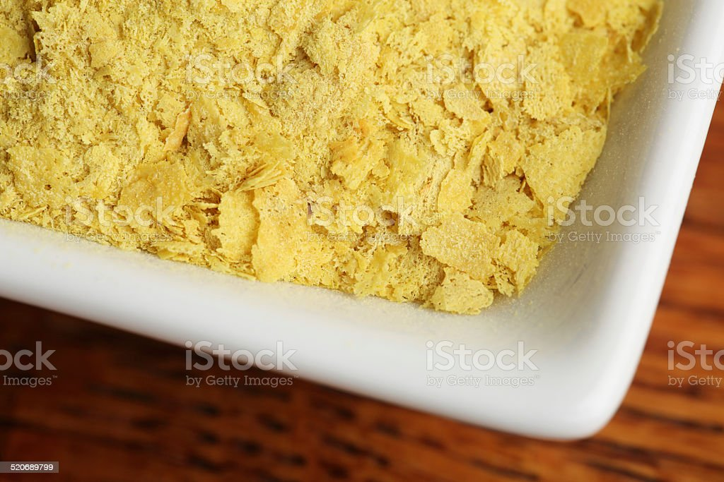 Dish of Nutritional Yeast on Wood stock photo