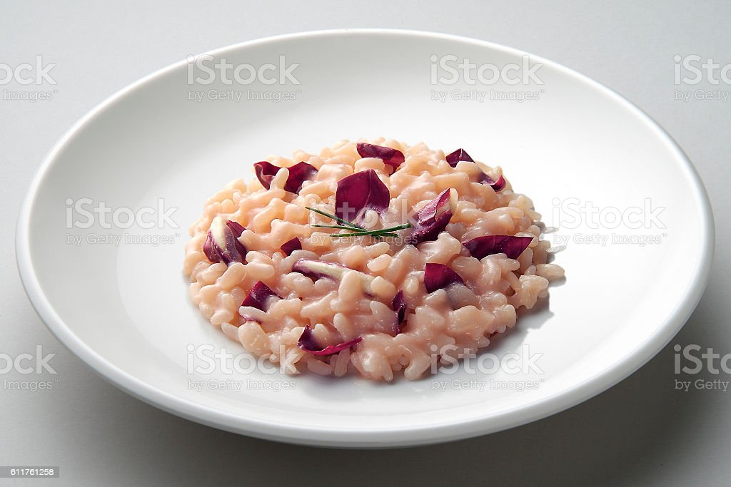 Dish of risotto with red radicchio stock photo