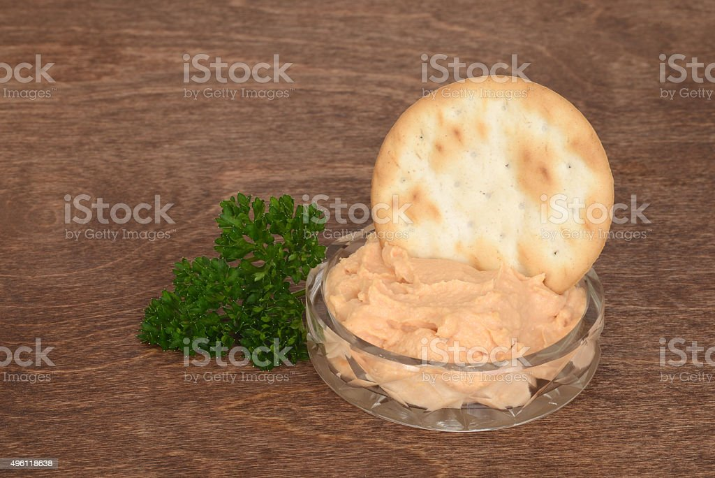 dish of salmon pate with parsley on wood stock photo