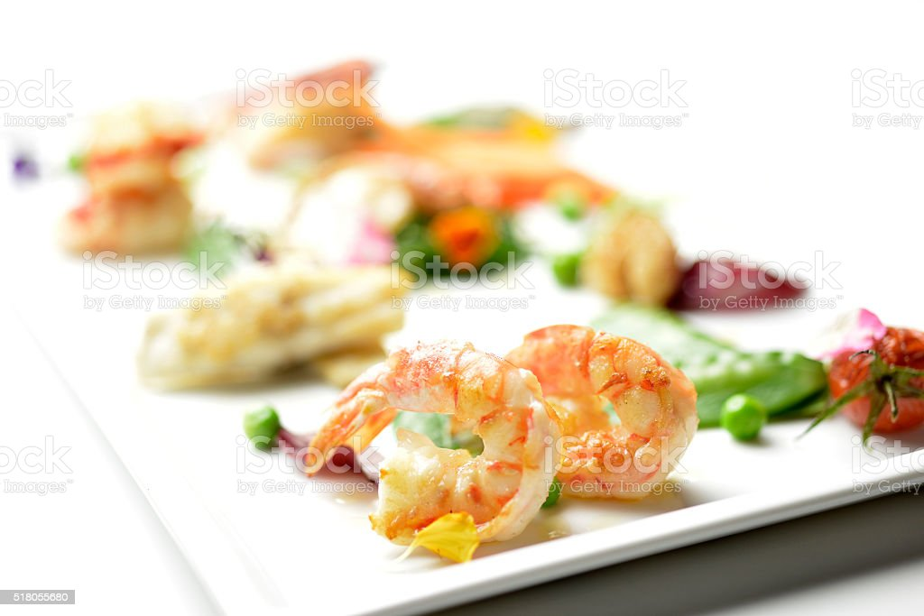 Dish of sea fish with spring vegetables stock photo