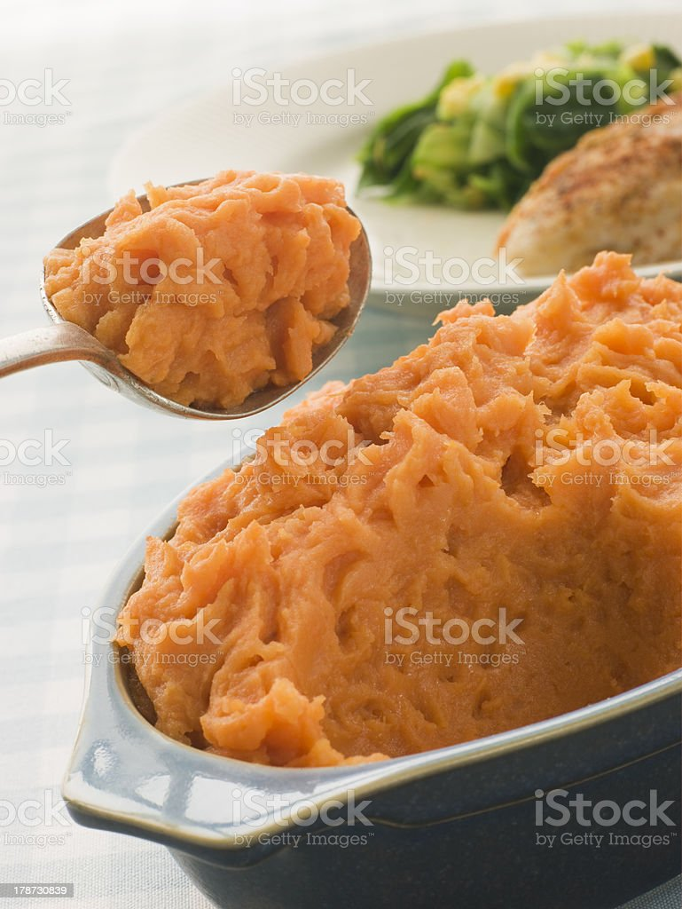 Dish Of Sweet Potato Mash With A Spoon stock photo