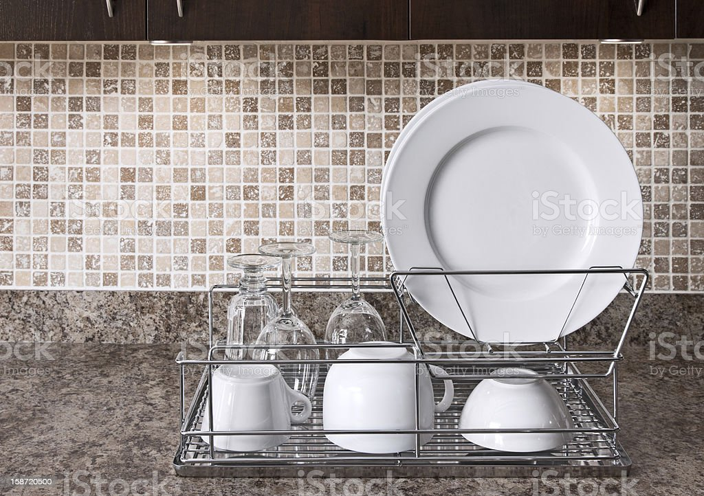 Dish rack on kitchen countertop stock photo