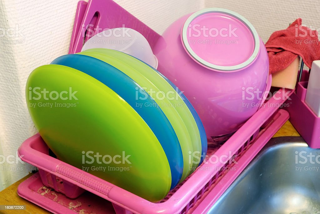Dish rack with colorfully dishware stock photo