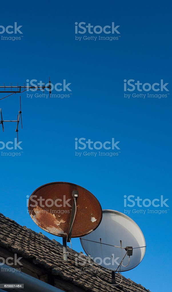Dish receptor fixed on the wall of house. stock photo