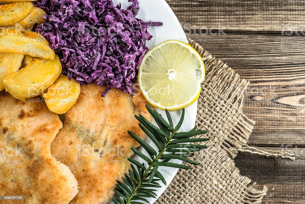 Dish with fried salmon, potatoes and vegetables. stock photo