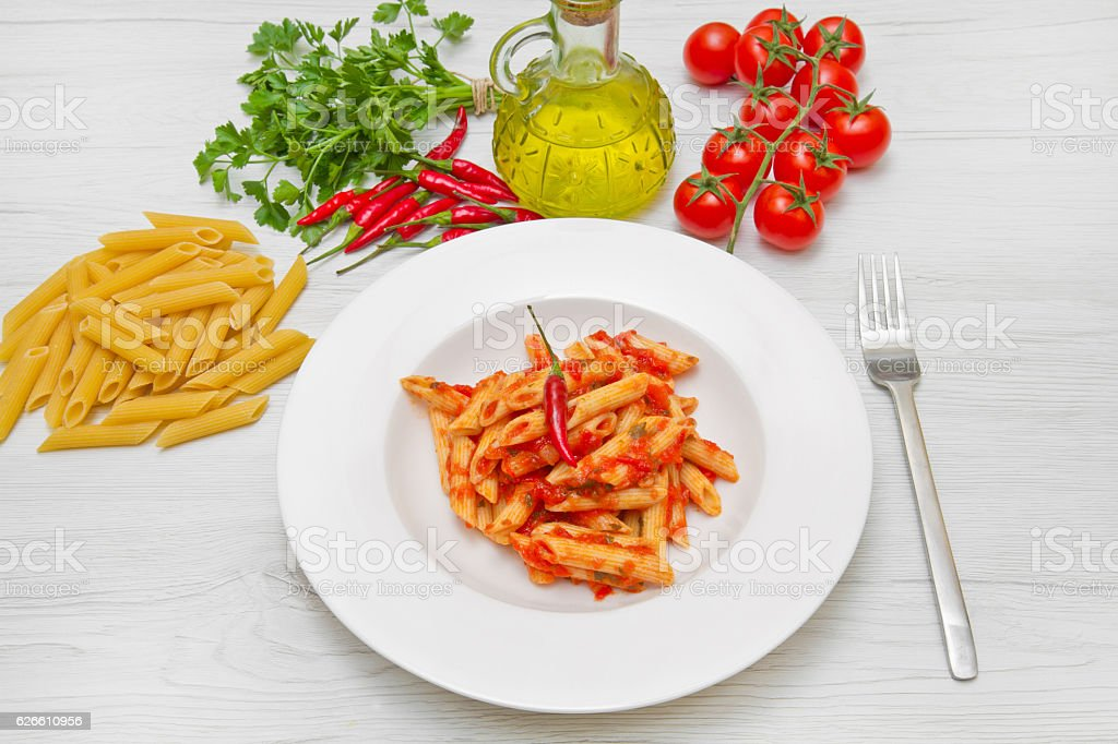 dish with penne and arrabbiata sauce stock photo