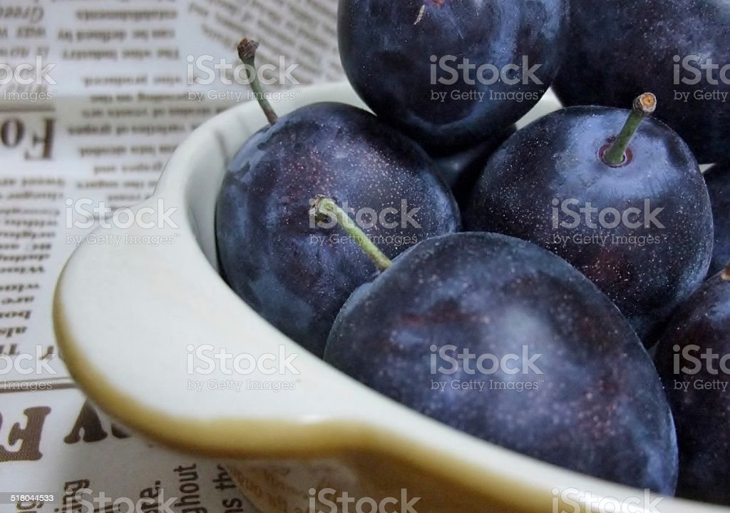 Dish with plums stock photo