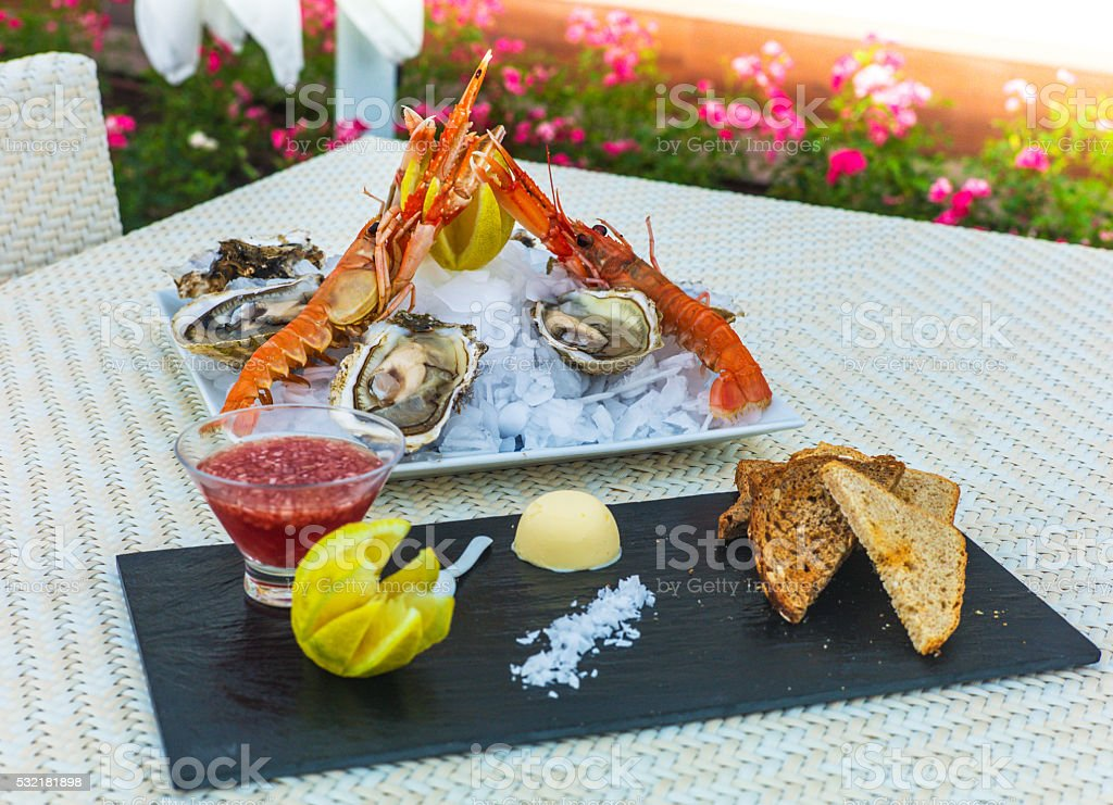 dish with prawns and oysters stock photo